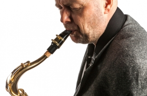Adult Man Playing Saxophone for Music Lessons in Toronto